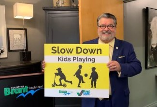 Kids at Play sign with Mayor David Bailey