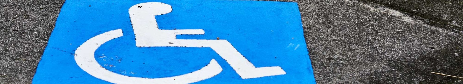 accessibility logo on parking spot